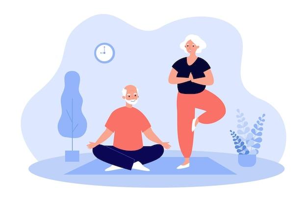 Pareja de adultos mayores haciendo yoga en casa, practicando la meditación en la estera