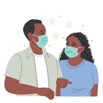 Pareja africana en máscaras médicas protectoras. precauciones durante un brote de coronavirus.