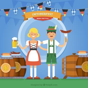 Pareja alemana comiendo y bebiendo en el oktoberfest