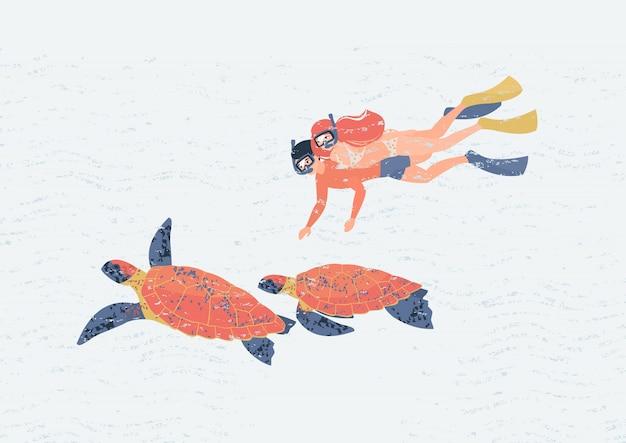 Pareja de amantes nada bajo el agua con un par de tortugas