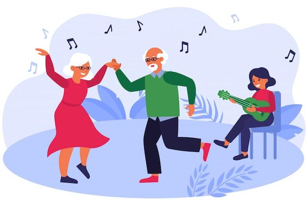 Pareja de ancianos bailando con música