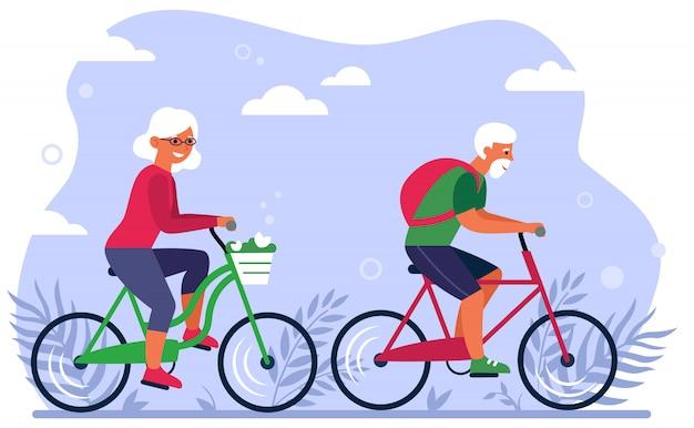 Pareja de ancianos en bicicleta en el parque