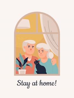 Pareja de ancianos con un gato en casa y mensajes de texto ¡quédese en casa!