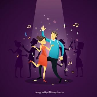Pareja bailando en la discoteca