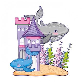 Pareja de ballenas animales con castillo y plantas de algas.