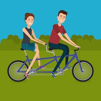 Pareja con bicicleta en el paisaje