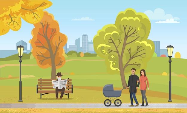 Pareja cochecito caminando otoño parque juntos