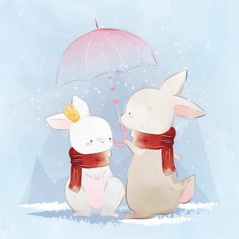 Pareja conejito bajo el paraguas