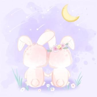 Pareja conejo sentado viendo una lluvia de meteoros dibujados a mano de dibujos animados