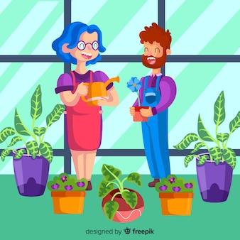 Pareja cuidando de las plantas