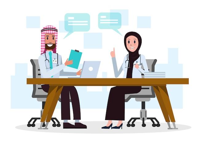 Pareja de médicos de arabia saudita hablando de casos médicos.