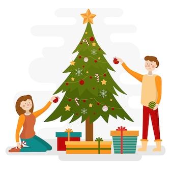 Pareja decorando el fondo de la temporada de invierno del árbol de navidad