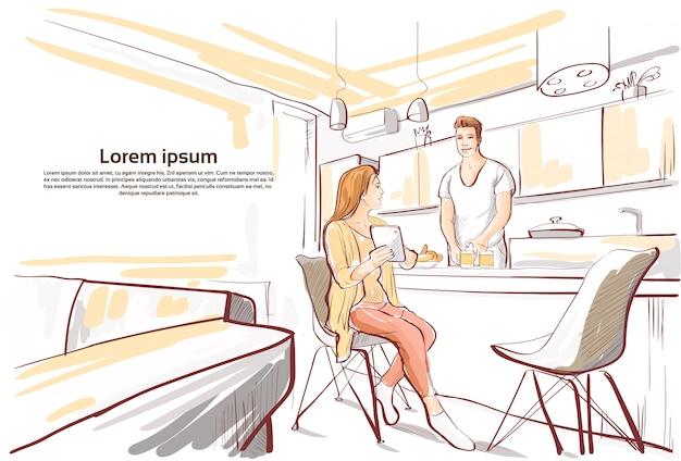 Pareja desayunando, mujer mostrar tableta computadora para hombre cocina comida cocina estudio