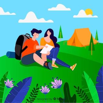 Pareja descansando en el campamento
