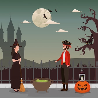 Pareja disfrazada con iconos en escena halloween