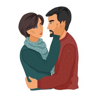 Pareja de enamorados, la mujer abraza a un hombre.