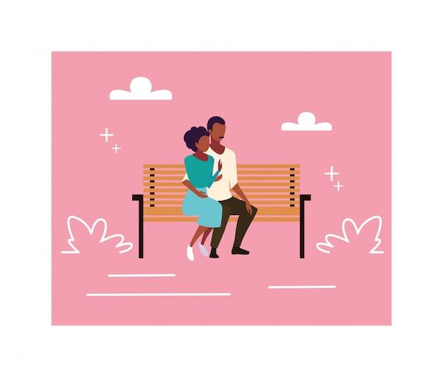 Pareja de enamorados sentados en la silla del parque
