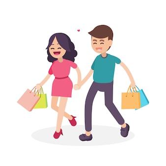 Pareja feliz con coloridos bolsos de compras