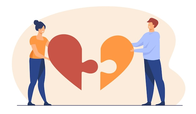 Pareja feliz conectando piezas de corazón juntas