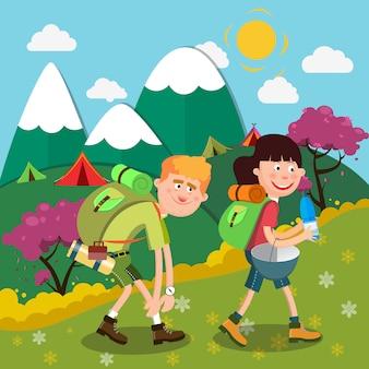 Pareja feliz senderismo en las montañas. personas activas