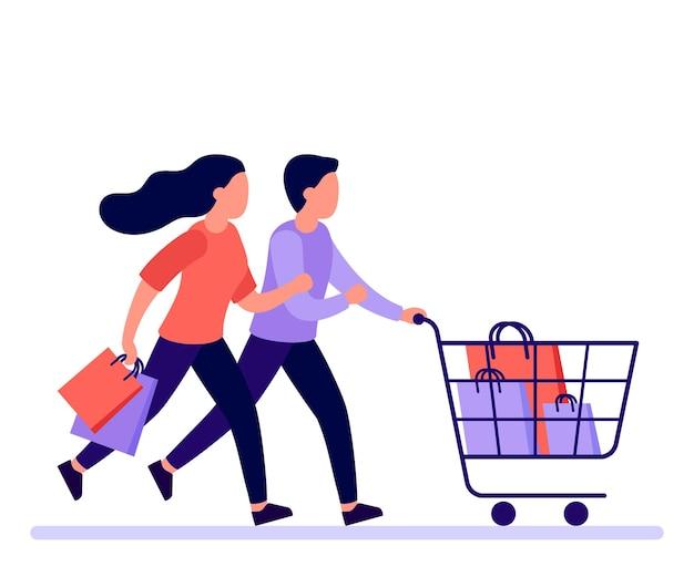 Pareja hombre y mujer se apresuran a correr con carrito de compras a la venta en la tienda los compradores se apresuran