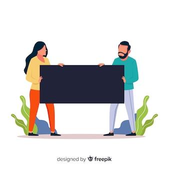 Pareja hombre y mujer sujetando un banner vacío