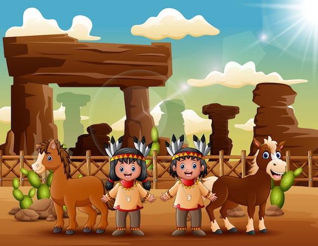 Pareja de indios de dibujos animados con animales en el desierto