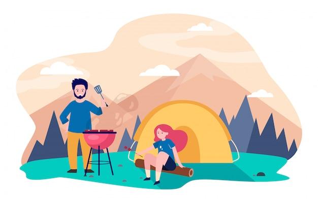Pareja joven acampando en las montañas