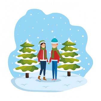 Pareja joven con ropa de invierno en paisaje nevado