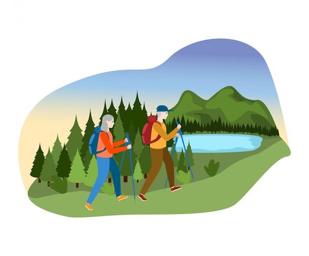 La pareja masculina femenina encantadora juntos acampa la colina al aire libre de la montaña, río del bosque del paseo del carácter de la persona en el blanco, ejemplo.