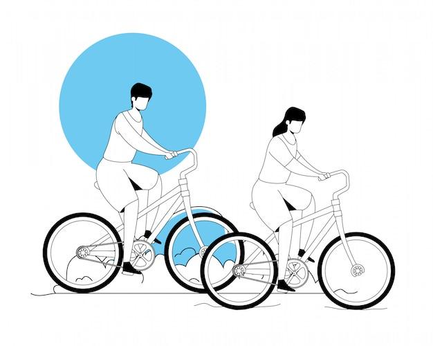 Pareja montando bicicleta en el paisaje del parque