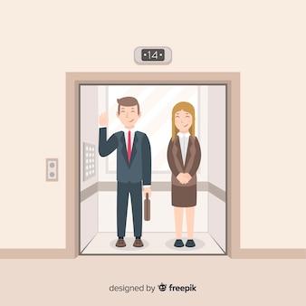 Pareja de negocios en ascensor