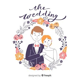 Pareja de novios de boda con adornos dibujado a mano