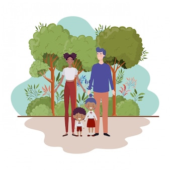 Pareja de padres con hijos en el paisaje