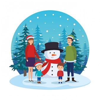 Pareja de padres con niños y muñeco de nieve en paisaje nevado