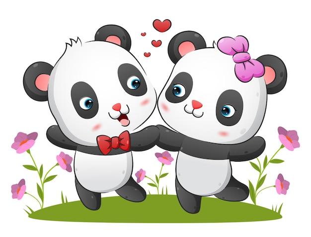 La pareja del panda kawaii baila junto con la expresión feliz en la ilustración del parque