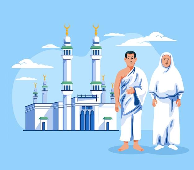 Pareja de peregrinos musulmanes de pie frente a masjid al haram.