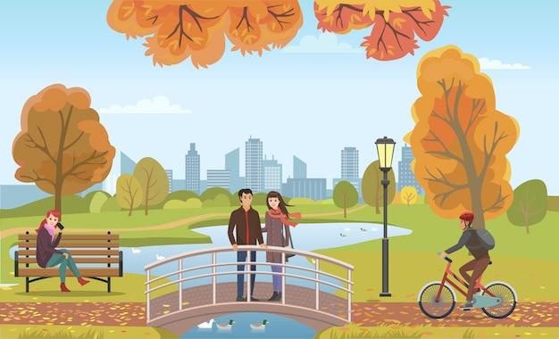 Pareja de personas enamoradas en el puente de otoño