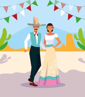 Pareja de personas con trajes típicos mexicanos.