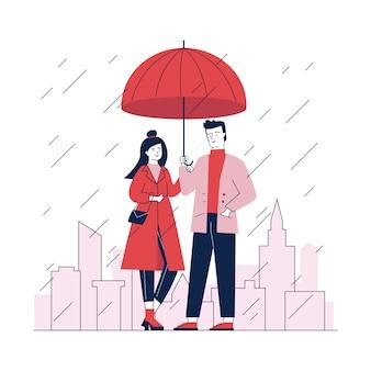Pareja de pie bajo el paraguas en la calle en lluvioso da