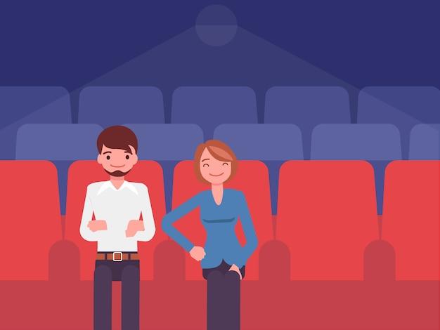 La pareja que está viendo en el cine.