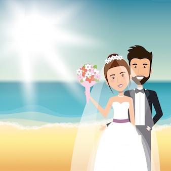 Pareja de recién casados en la playa