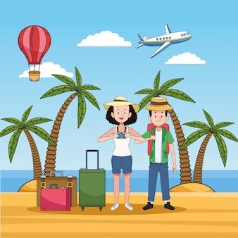 Pareja de turistas en la playa con maletas
