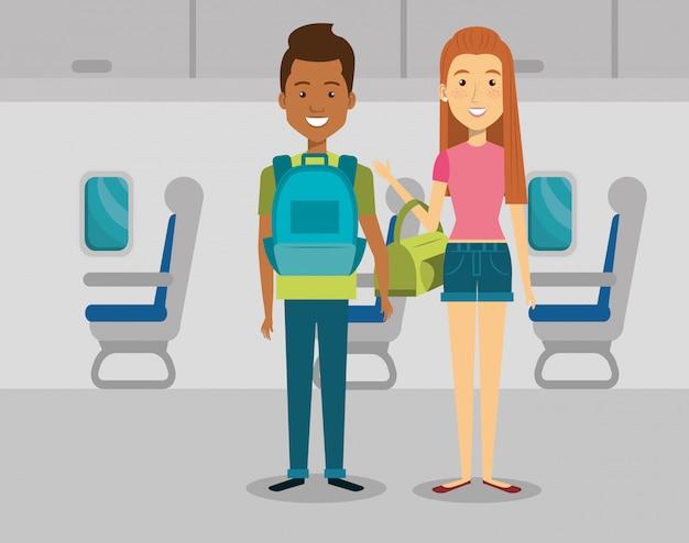 Pareja de viajeros en el avión