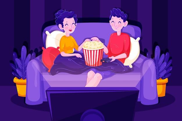Pareja viendo una película en su sofá