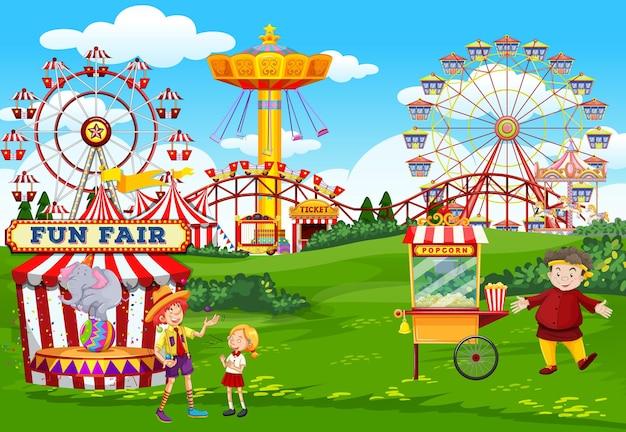 Parque de atracciones con circo y escena temática de carrito de palomitas de maíz.