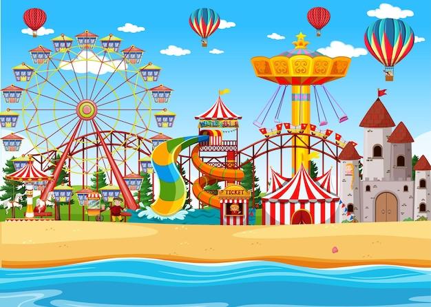 Parque de atracciones con escena junto a la playa durante el día con globos en el cielo
