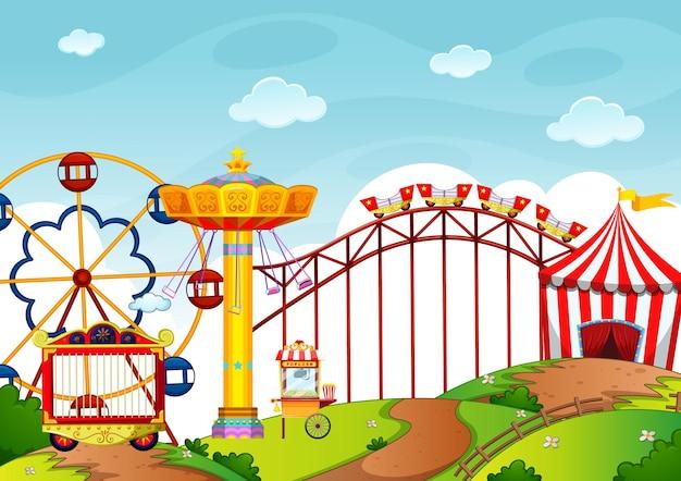 Parque de atracciones con muchas atracciones y tiendas.