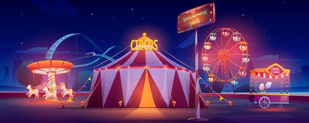 Parque de atracciones en la noche