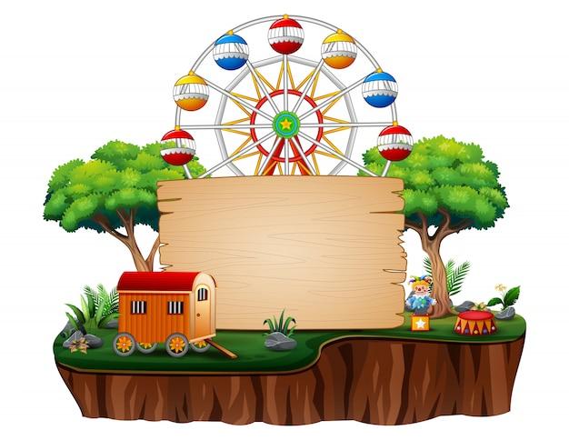 Parque de atracciones con la noria sobre la naturaleza